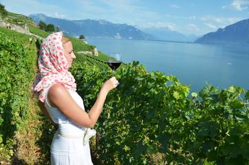 Woman tasting red wine in Lavaux, Switzerland