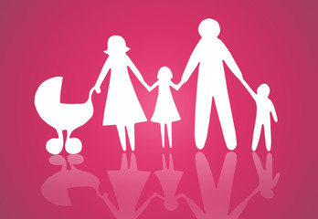 Closeup of paper family on pink background