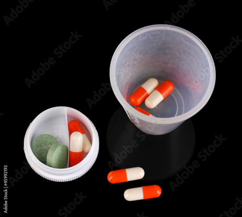 Dispensers for tablets with pills isolated on black