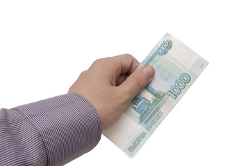 Hand holds a banknote of 1000 rubles