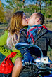 Beautiful couple sitting on the bike and kisses