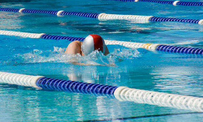 Breaststroke swimmer in outdoor swim meet