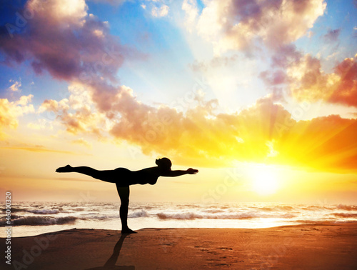Yoga silhouette on the beach