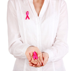 Woman with pink ribbon in hands isolated on white