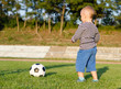 Little boy learning to play soccer