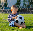 Little boy in the goal with his soccer ball