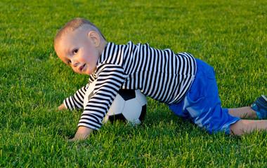 Boy diving on a soccer ball