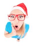 Ho ho ho - excited Santa girl isolated on white