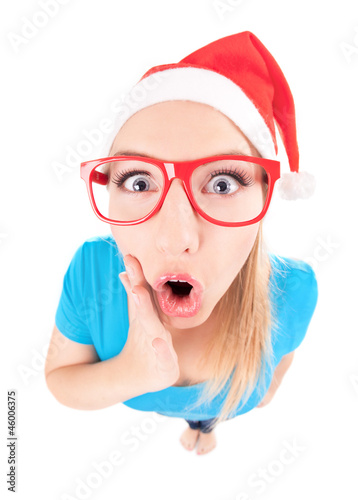 Ho ho ho - excited Santa girl isolated on white