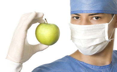 doctor holding a green apple
