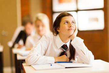 high school girl daydreaming in classroom