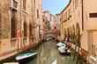 The narrow street - channel in Venice
