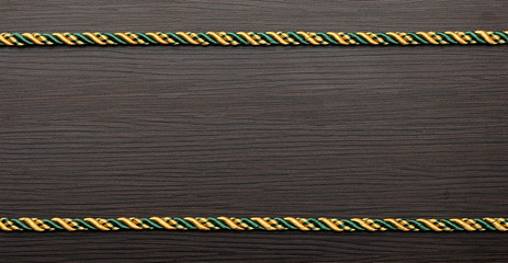 colorful rope frame on wooden background