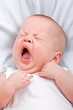 the newborn yawns