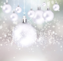 Christmas balls hanging with ribbons on abstract background