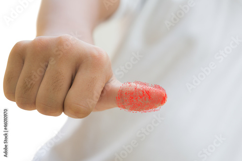 Thumb with a red fingerprint