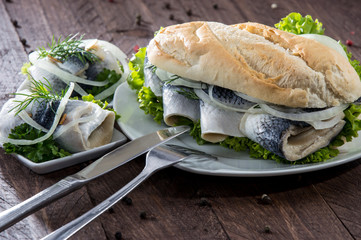 Herring Filet on a baguette (against wood)