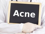 Doctor shows information on blackboard: acne poster