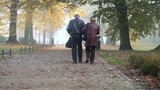 Senior couple in  misty fall park