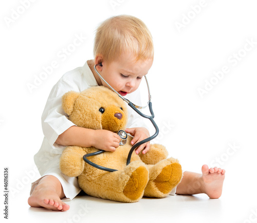 Adorable child with clothes of doctor and teddy bear over white - 46016336