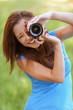 young woman smiles and photographs