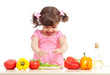 Little kid preparing vegetable salad. Concept of healthy food.