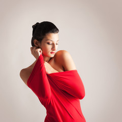 Portrait of beautiful brunette woman with red elastic cloth.