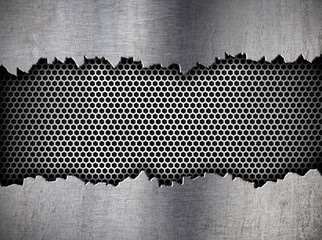silver hexagon metal grate background in ripped hole