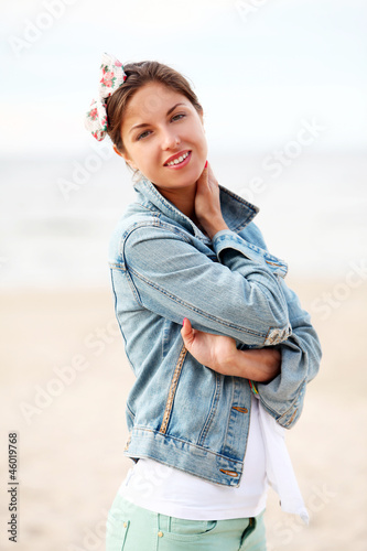 Young woman is walking and relaxes on the beach