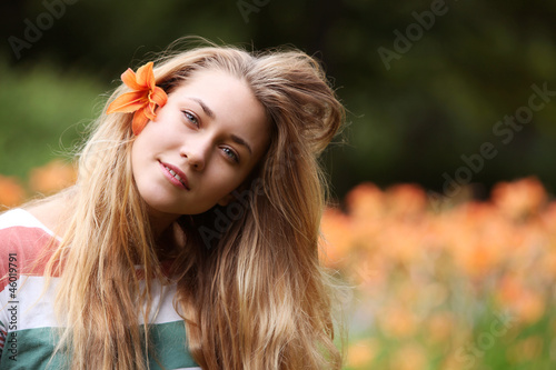 young girl with lily flower in hair