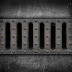 griglia forata contro parete cemento
