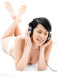 Woman in bra listens to music through the black earphones