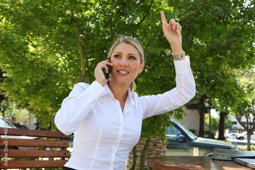 Blonde Business Woman Waving