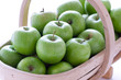 green granny smith apples in a trug