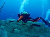 diver explores a wreck
