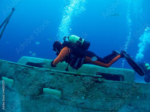 diver explores a wreck - 46030717