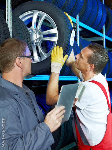 Master mechanics look for a tire with touchpad in a warehouse