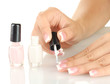 Woman makes herself a French manicure, on white background
