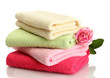 bright towels and rose isolated on white