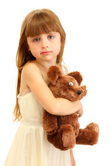 Portrait of beautiful cute girl with toy bear isolated on white