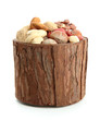 assortment of tasty nuts in wooden vase, isolated on white