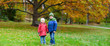 Two kids in an autumn park