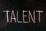 The word TALENT in stencil letters on a blackboard poster