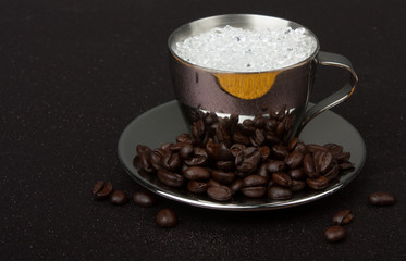 Stainless steel espresso cup on saucer