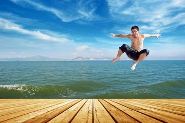 Beach jumping man