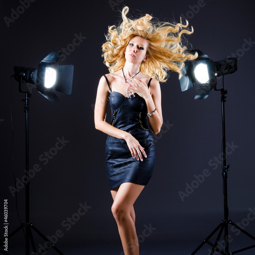 Attractive woman in studio shooting