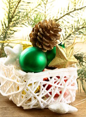 box of Christmas toys and decorations on wooden background