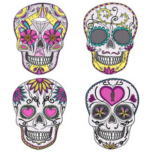 Mexican skull set. Colorful skulls with flower and heart ornamen