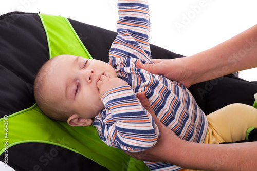 Toddler sleeping in a baby lounger