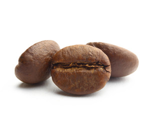 three coffee beans on white background